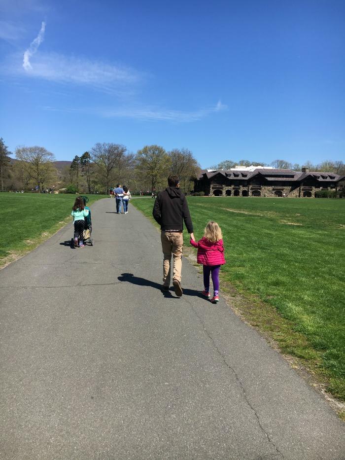 family strolls in Bear Mountain.