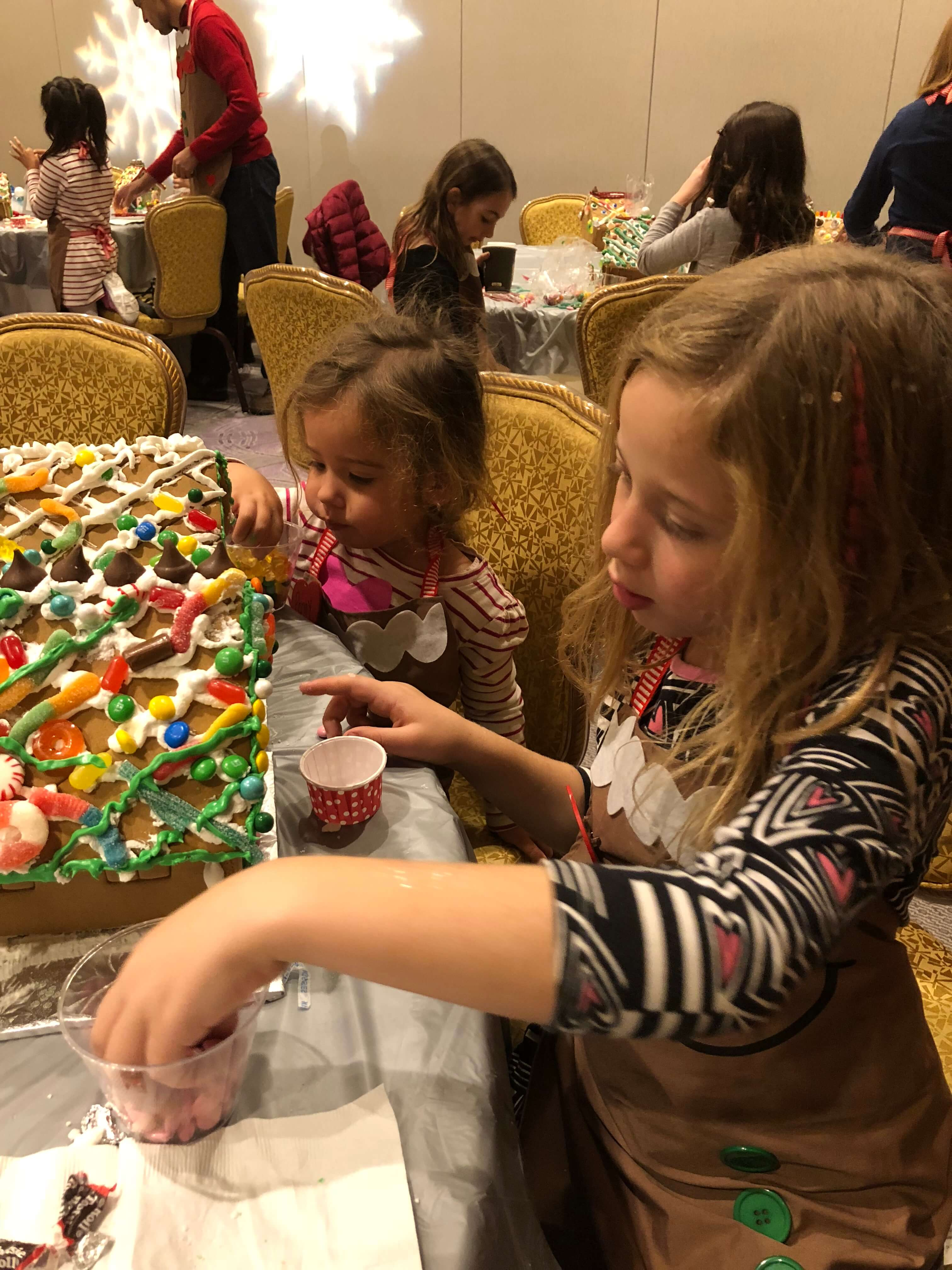 gingerbread house decorating adding icing westchester events process