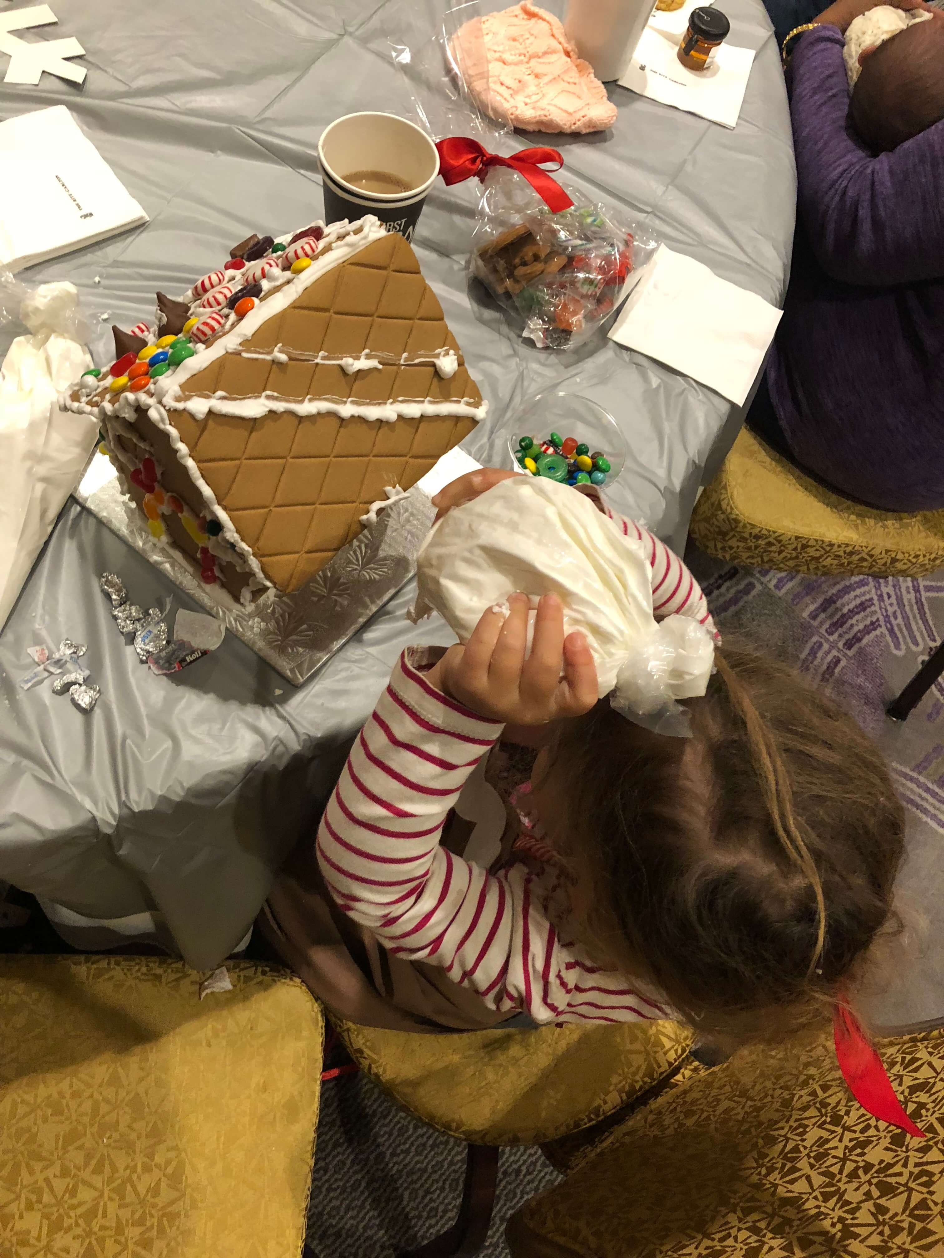 gingerbread house decorating adding squeezing icing westchester events