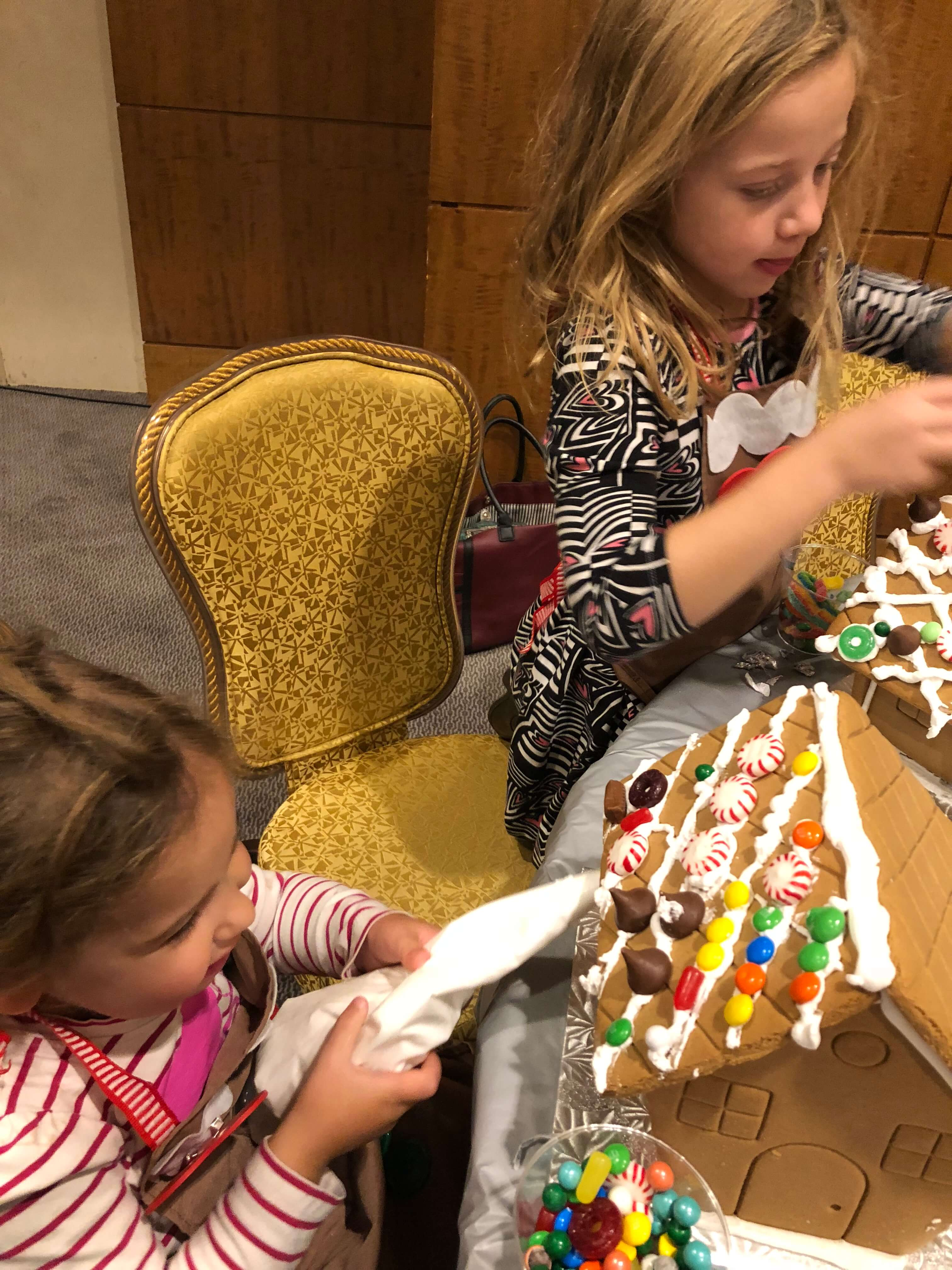 gingerbread house decorating adding icing and adding candy westchester events