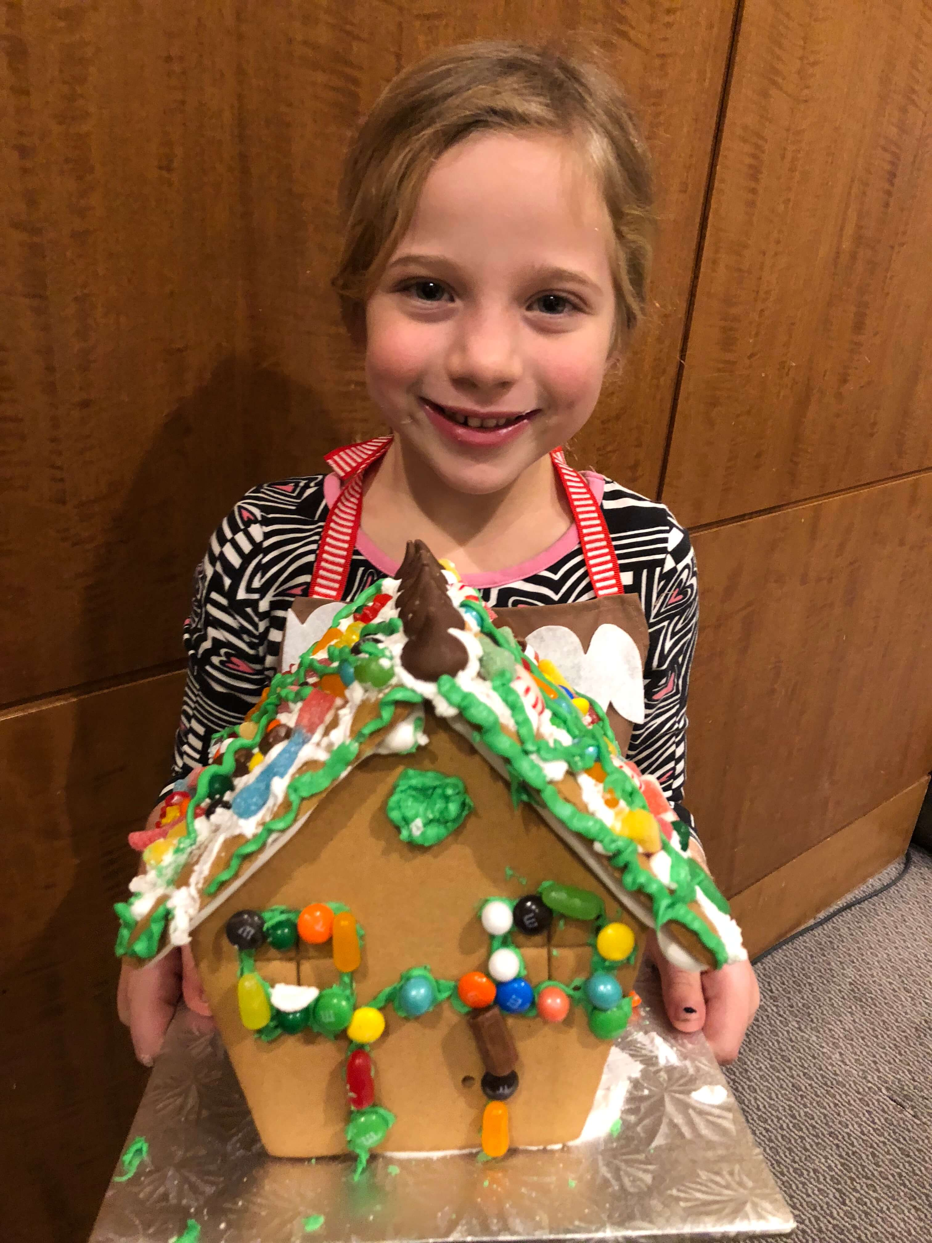 gingerbread house decorating adding icing westchester events finished house