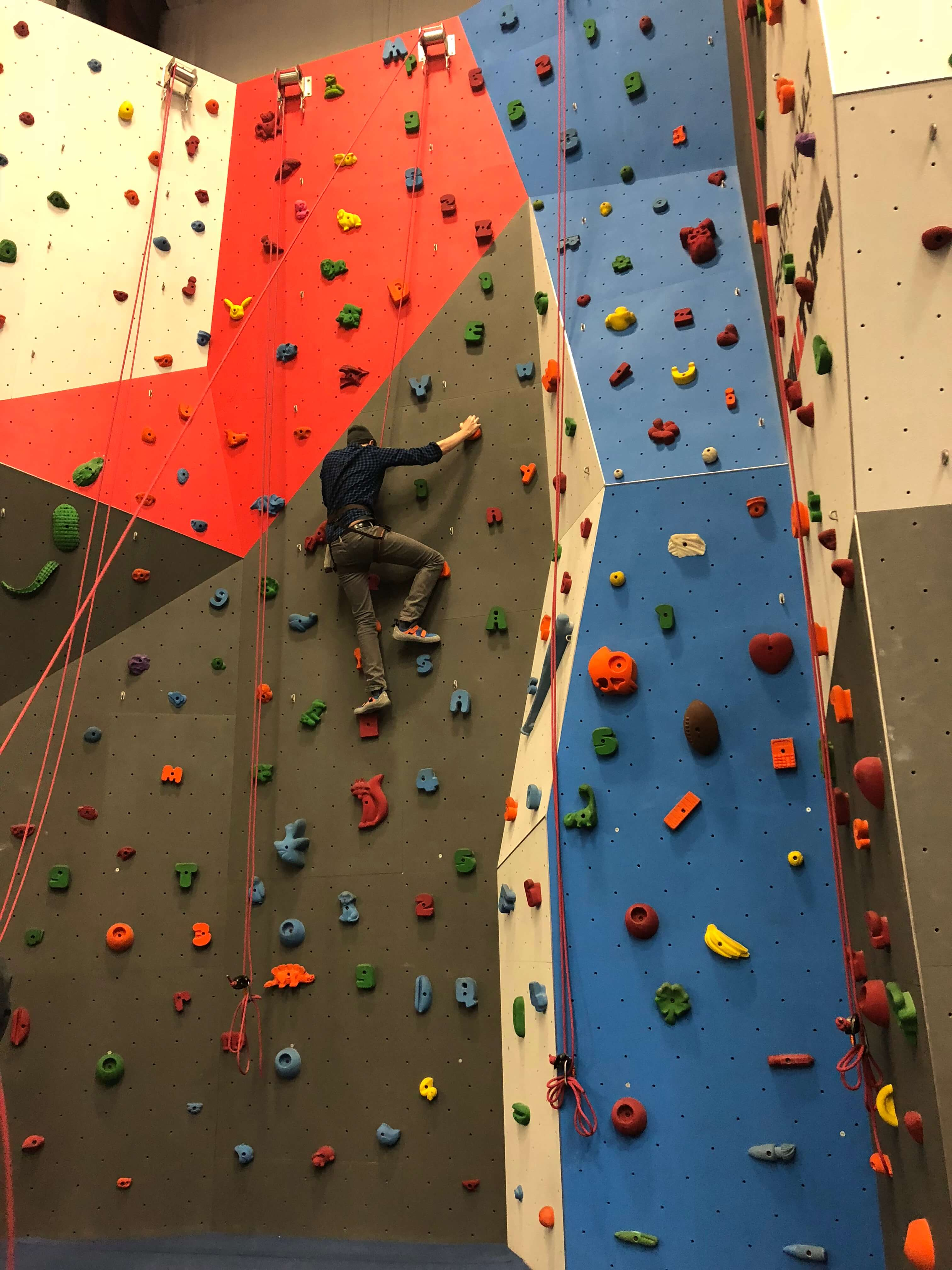 dad climbing at gravity vault in dutchess county