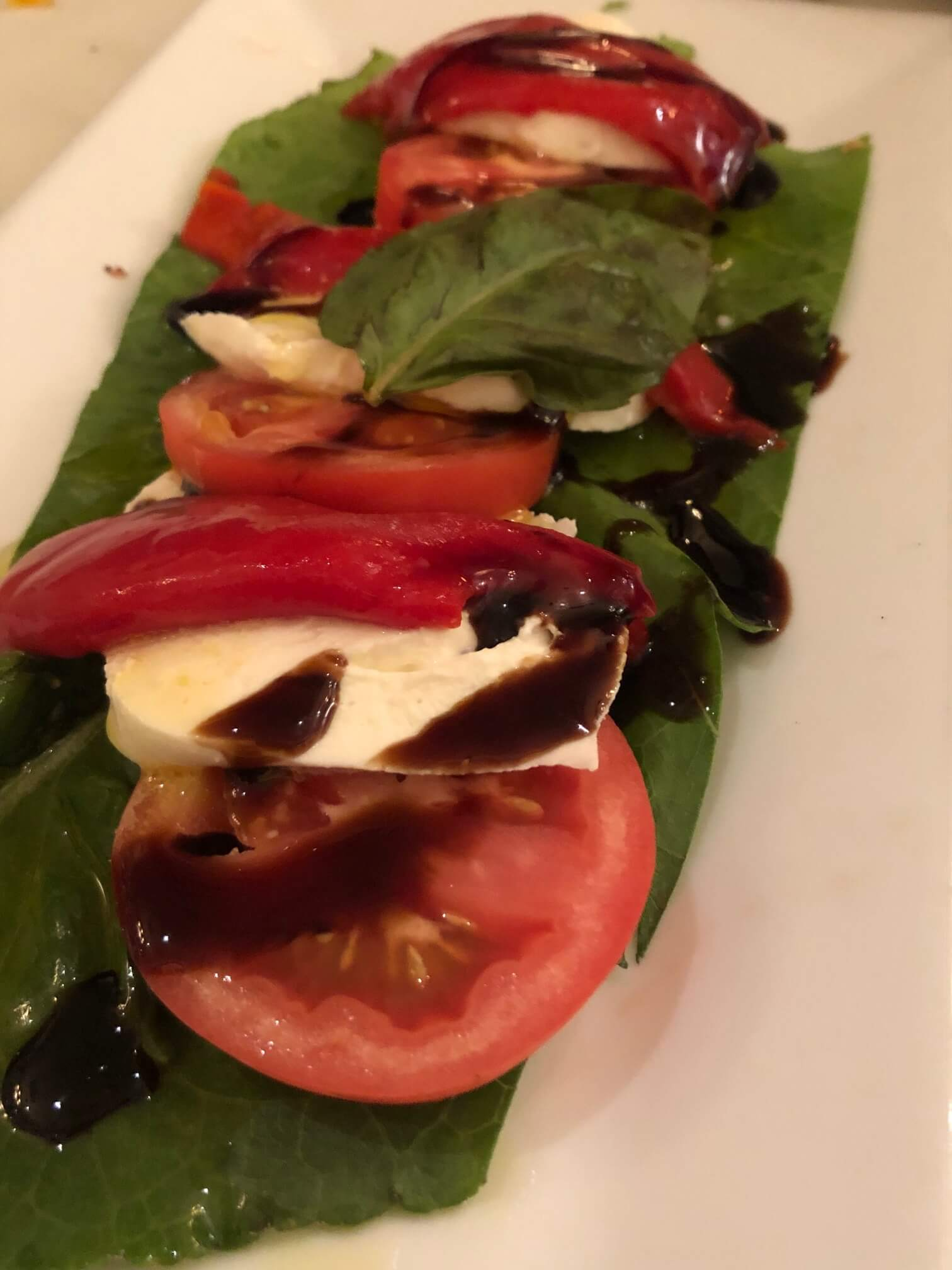 Mozzarella Caprese from Mario's featuring Fresh Mozzarella, Sliced Tomatoes, Roasted Peppers