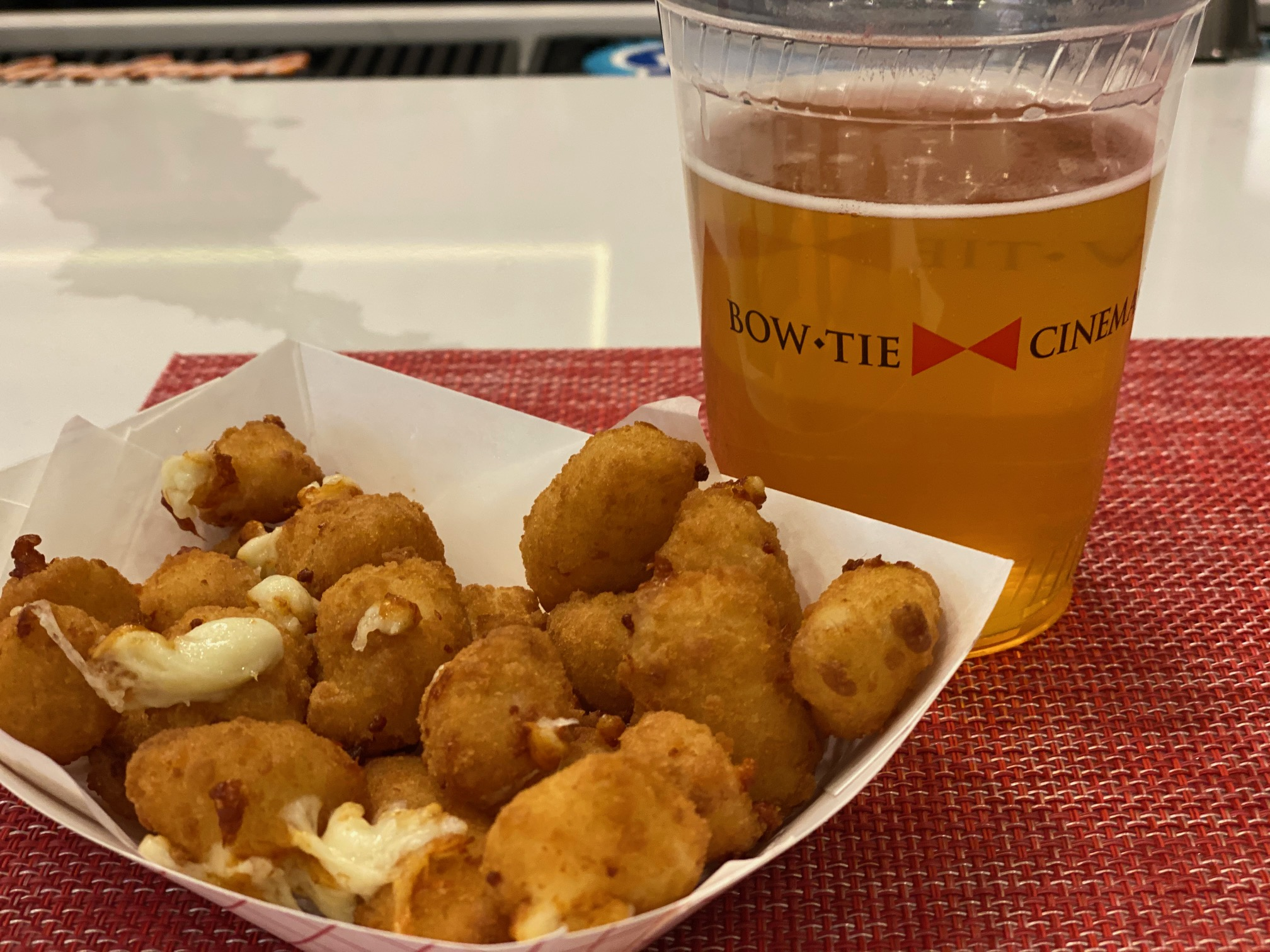 Upgraded Movie-Going Experience at the Bow Tie Cinemas and Majestic Bar in Stamford with beer and cheese curds